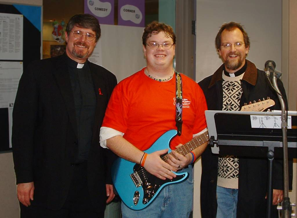 Tom poses with two priests, Aids Day Celebration 2005