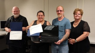 Michael Harrison, Yolanda Moreno and Paul Scalf graduate from a 5 week course in computer basics