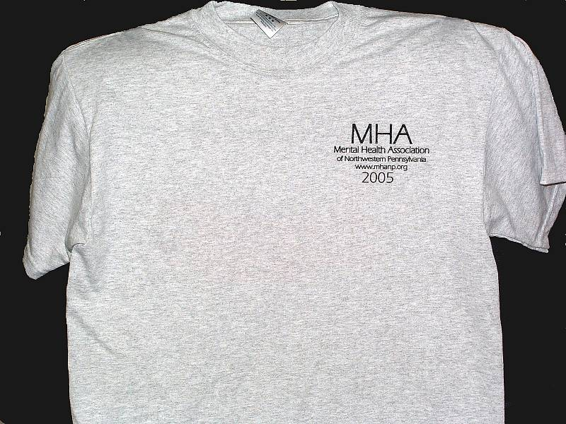 Front view of t-shirt. Light gray with small logo over left front chest area.